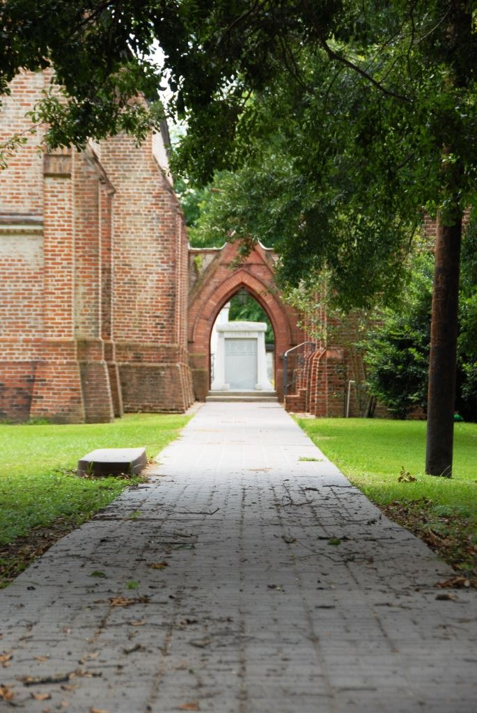 A brick walkway leading to Christ Episcopal church